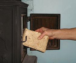 Loading Briquette into woodburner
